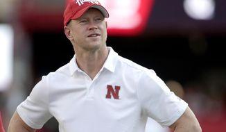 Nebraska head coach Scott Frost follows warmups before an NCAA college football game against Northern Illinois in Lincoln, Neb., Saturday, Sept. 14, 2019. (AP Photo/Nati Harnik)