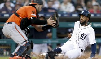 Detroit Tigers' Willi Castro slides safe into home plate against Baltimore Orioles catcher Austin Wynns on a hit from Tigers batter Victor Reyes during the fifth inning of a baseball game Saturday, Sept. 14, 2019, in Detroit. (AP Photo/Raj Mehta)