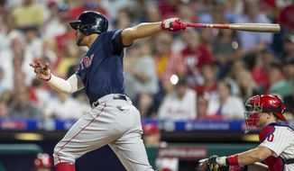 Boston Red Sox's Xander Bogaerts (2) follows through on a single during the fourth inning of a baseball game against the Philadelphia Phillies, Saturday, Sept. 14, 2019, in Philadelphia. (AP Photo/Laurence Kesterson)