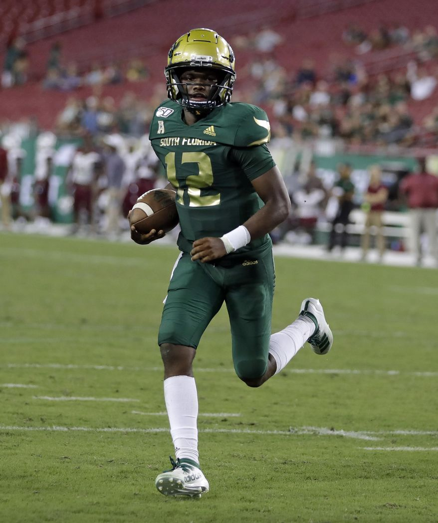 South Florida quarterback Jordan McCloud (12) runs into the end zone for a touchdown against South Carolina State during the second half of an NCAA college football game Saturday, Sept. 14, 2019, in Tampa, Fla. (AP Photo/Chris O'Meara)