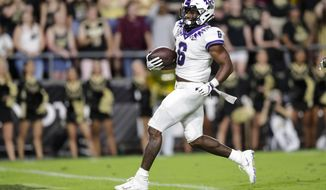 TCU running back Darius Anderson runs in for a touchdown against Purdue during the first half of an NCAA college football game in West Lafayette, Ind., Saturday, Sept. 14, 2019. (AP Photo/Michael Conroy)