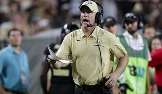 Purdue coach Jeff Brohm yells to an official during the second half of the team's NCAA college football game against TCU in West Lafayette, Ind., Saturday, Sept. 14, 2019. (AP Photo/Michael Conroy)