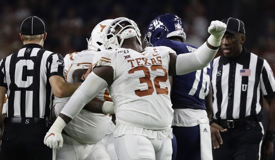 Texas defensive lineman Malcolm Roach (32) celebrates a stop against Rice during the first half of an NCAA college football game Saturday, Sept. 14, 2019, in Houston. (AP Photo/Eric Gay)