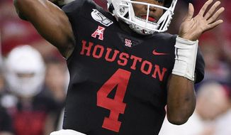Houston quarterback D'Eriq King throws a pass during the first half of the team's NCAA college football game against Washington State, Friday, Sept. 13, 2019, in Houston. (AP Photo/Eric Christian Smith)