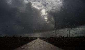 Rain drops cover a car's window shield prior to the arrival of a new tropical depression, that turned into Tropical Storm Humberto, in the aftermath of Hurricane Dorian en route to Mclean's Town, Grand Bahama, Bahamas, Friday Sept. 13, 2019. Humberto narrowly missed the island over the weekend. (AP Photo/Ramon Espinosa)