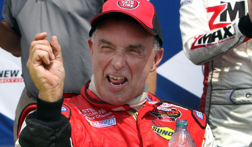 Driver Mike Stefanik smiles as he shows off how much he won by during the NASCAR Whelen Modified Tour auto race Saturday July 14. 2012 at New Hampshire Motor Speedway in Loudon, N.H. Stefanik beat Ron Silk. (AP Photo/Jim Cole)