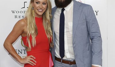 EMILY WILKINSON AND BAKER MAYFIELD                                                   Cleveland Browns QB Baker Mayfield and Emily Wilkinson walk the red carpet before the 145th running of the Kentucky Derby horse race at Churchill Downs Saturday, May 4, 2019, in Louisville, Ky. (AP Photo/Gregory Payan)