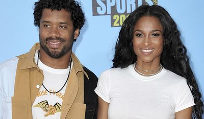 CIARA  AND RUSSELL WILSON                                                                                                                                        NFL player Russell Wilson, of the Seattle Seahawks, left, and Ciara arrive at the Kids' Choice Sports Awards on Thursday, July 11, 2019, at the Barker Hangar in Santa Monica, Calif. (Photo by Richard Shotwell/Invision/AP)