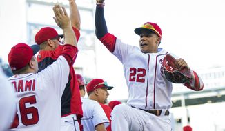 Washington Nationals Juan Soto (22) celebrates with teammates after winning 7-0 in a baseball game against the Atlanta Braves in Washington, Sunday, Sept. 15, 2019. (AP Photo/Manuel Balce Ceneta)