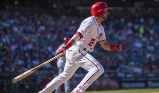 Washington Nationals Adam Eaton (2) watches after hitting the ball during the sixth inning of a baseball game against the Atlanta Braves in Washington, Sunday, Sept. 15, 2019. (AP Photo/Manuel Balce Ceneta)