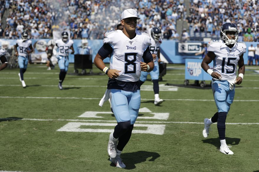 Tennessee Titans quarterback Marcus Mariota (8) runs onto the field before an NFL football game against the Indianapolis Colts Sunday, Sept. 15, 2019, in Nashville, Tenn. (AP Photo/James Kenney)