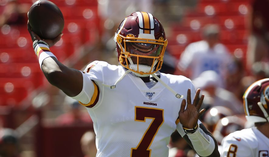 Washington Redskins quarterback Dwayne Haskins warming up on the field before the start of an NFL football game against Dallas Cowboys, Sunday, Sept. 15, 2019, in Landover, Md. (AP Photo/Alex Brandon)