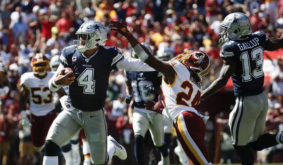 Dallas Cowboys quarterback Dak Prescott (4) breaks away from Washington Redskins cornerback Josh Norman (24) to run downfield in the first half of an NFL football game, Sunday, Sept. 15, 2019, in Landover, Md. Also on the field is Dallas Cowboys wide receiver Michael Gallup (13). (AP Photo/Alex Brandon)