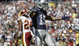 Dallas Cowboys wide receiver Devin Smith celebrates his touchdown against Washington Redskins cornerback Josh Norman (24) in the first half of an NFL football game Sunday, Sept. 15, 2019, in Landover, Md. (AP Photo/Evan Vucci)