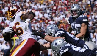 Dallas Cowboys defensive end Demarcus Lawrence (90) and outside linebackers Sean Lee (50) and Leighton Vander Esch (55) chase Washington Redskins running back Adrian Peterson (26) during an NFL football game, Sunday, Sept. 15, 2019, in Landover, Md. (AP Photo/Mark Tenally) **FILE**