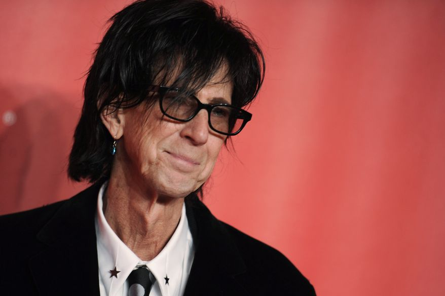 In this Feb. 6, 2015, file photo, Ric Ocasek of the Cars arrives at the MusiCares Person of the Year event at the Los Angeles Convention Center in Los Angeles. Ocasek, famed frontman for The Cars rock band, has been found dead in a New York City apartment. The New York City police department said officers responding to a 911 call found the 75-year-old Ocasek on Sunday, Sept. 15, 2019. (Photo by Richard Shotwell/Invision/AP, File)