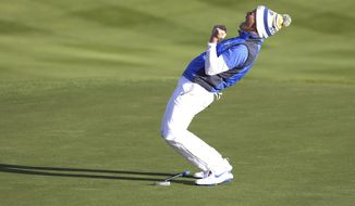 Suzann Pettersen of Europe celebrates after holing a putt on the 18th green to win the Solheim Cup against the US at Gleneagles, Auchterarder, Scotland, Sunday, Sept. 15, 2019. (AP Photo/Peter Morrison)