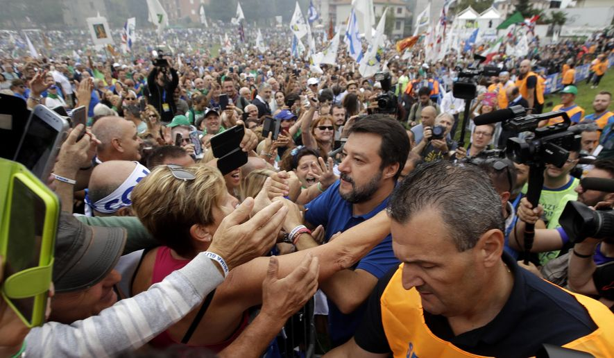 Leader of The League party, Matteo Salvini, is cheered by supporters at a party's rally in Pontida, northern Italy, Sunday, Sept. 15, 2019. Thousands of die-hard League voters from across northern Italy were gathering in a foothill Lombard town with long historical associations to nationalist movements as Matteo Salvini relaunches himself as Italy's opposition leader after a grave political miscalculation landed the party out of government. (AP Photo/Luca Bruno)