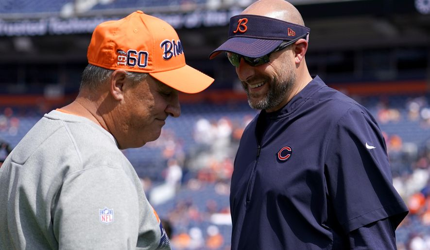 Denver Broncos head coach Vic Fangio, left, talks with Chicago Bears head coach Matt Nagy prior to an NFL football game, Sunday, Sept. 15, 2019, in Denver. (AP Photo/Jack Dempsey)