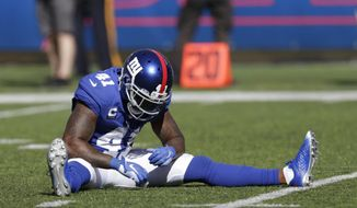New York Giants' Antoine Bethea sits on the field after a play during the second half of an NFL football game against the Buffalo Bills, Sunday, Sept. 15, 2019, in East Rutherford, N.J. (AP Photo/Adam Hunger)