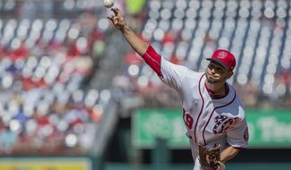 Washington Nationals starting pitcher Anibal Sanchez (19) throws a pitch during the first inning of a baseball game against the Atlanta Braves in Washington, Sunday, Sept. 15, 2019. (AP Photo/Manuel Balce Ceneta)