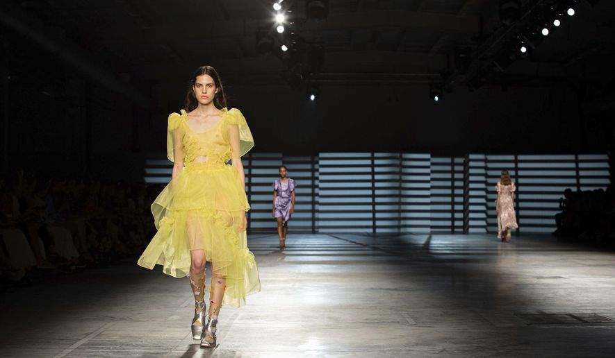 Models display creations by Preen by Thornton Bregazzi at the Spring/Summer 2020 fashion week runway show presented in London, Sunday, Sept. 15, 2019. (Kate Collins/PA via AP)
