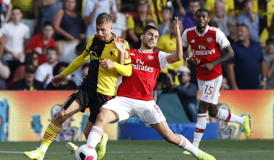 Watford's Gerard Deulofeu, left, vies for the ball with Arsenal's Dani Ceballos during their English Premier League soccer match between Watford and Arsenal at the Vicarage Road stadium in Watford near London, Sunday, Sept. 15, 2019. (AP Photo/Alastair Grant)