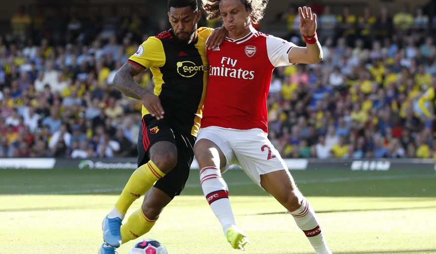 Arsenal's David Luiz, right, vies for the ball with Watford's Abdoulaye Doucoure during the English Premier League soccer match between Watford and Arsenal at the Vicarage Road stadium in Watford near London, Sunday, Sept. 15, 2019. (AP Photo/Alastair Grant)