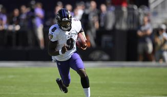 Baltimore Ravens quarterback Lamar Jackson rushes the ball in the first half of an NFL football game against the Arizona Cardinals, Sunday, Sept. 15, 2019, in Baltimore. (AP Photo/Nick Wass) **FILE**
