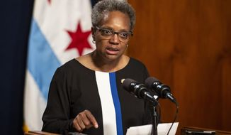 """We're not as concerned about the economics, Chicago Mayor Lori Lightfoot said of the new policy. """"This is about educating folks, giving them access to learning, having a safe space where people can come and learn."""" (Ashlee Rezin/Chicago Sun-Times via AP File)"""