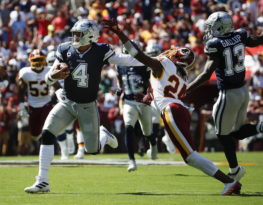 Dallas Cowboys quarterback Dak Prescott (4) breaks away from Washington Redskins cornerback Josh Norman (24) to run downfield in the first half of an NFL football game, Sunday, Sept. 15, 2019, in Landover, Md. Also on the field is Dallas Cowboys wide receiver Michael Gallup (13). (AP Photo/Alex Brandon)