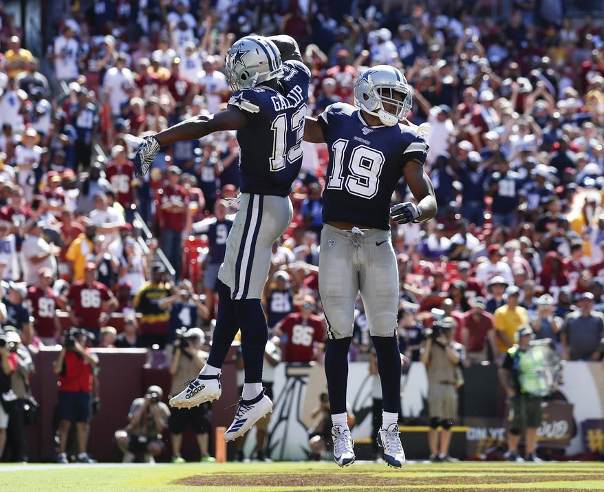 Dallas Cowboys wide receiver Amari Cooper (19) celebrates his touchdown with teammate wide receiver Michael Gallup (13) in the second half of an NFL football game, Sunday, Sept. 15, 2019, in Landover, Md. (AP Photo/Alex Brandon)