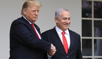 FILE - In this March 25, 2019 file photo, President Donald Trump welcomes visiting Israeli Prime Minister Benjamin Netanyahu to the White House in Washington.  Netanyahu, locked in a razor tight race and facing the likelihood of criminal corruption charges, a decisive victory in Tuesday, Sept. 17, vote may be the only thing to keep him out of the courtroom.  (AP Photo/Manuel Balce Ceneta, File)