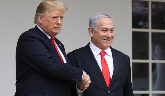 In this March 25, 2019, file photo, President Donald Trump welcomes visiting Israeli Prime Minister Benjamin Netanyahu to the White House in Washington. (AP Photo/Manuel Balce Ceneta, File)
