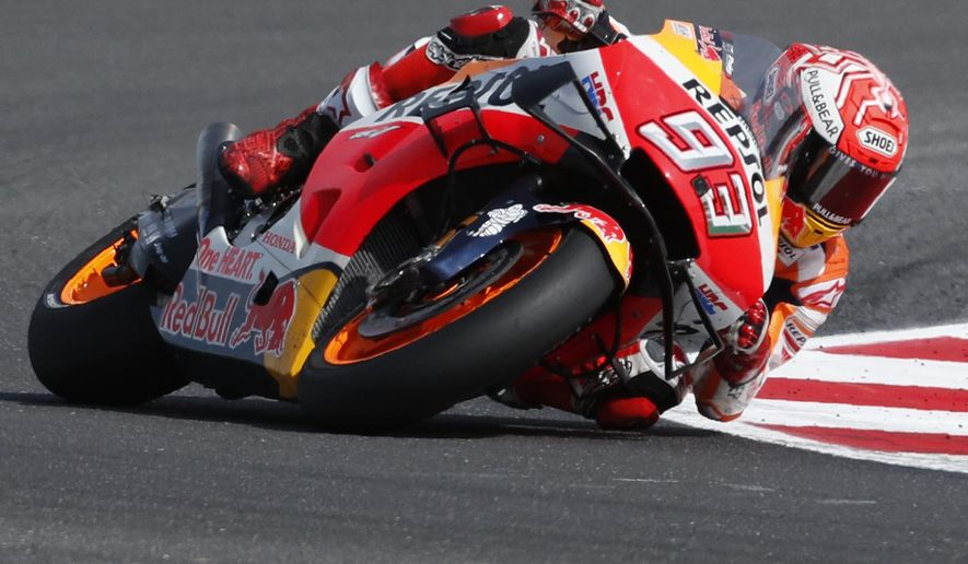 Race winner Spain's Marc Marquez steers his motorbike during the San Marino Motorcycle Grand Prix at the Misano circuit in Misano Adriatico, Italy, Sunday, Sept. 15, 2019. (AP Photo/Antonio Calanni)