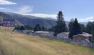 ADVANCE ON THURSDAY, SEPT. 12 FOR USE ANY TIME AFTER 3:01 A.M. SUNDAY SEPT 15 - In this Sept. 6, 2019, photo the Aspens Mobile Home Village sits tucked between I-70 eastbound and the Eagle River in Avon, Colo. Nearly 50 years old, it has 159 lots and is home to several hundred immigrant workers in Eagle county's construction, service and hospitality industries. (Tina Griego/ Colorado Independent)