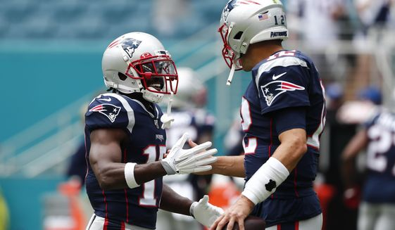 New England Patriots quarterback Tom Brady (12) greets wide receiver Antonio Brown (17) before the start of an NFL football game against the Miami Dolphins, Sunday, Sept. 15, 2019, in Miami Gardens, Fla. (AP Photo/Brynn Anderson) ** FILE **