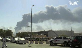 Smoke from a fire at the Abqaiq oil processing facility fills the skyline, in Buqyaq, Saudi Arabia. (Al-Arabiya via AP, File)
