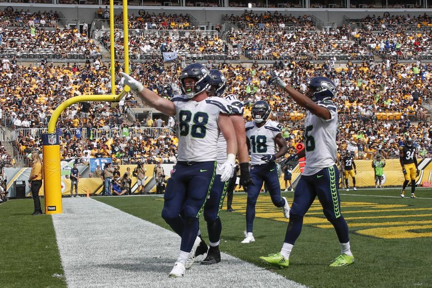 Seattle Seahawks tight end Will Dissly (88) celebrates with teammates after making a touchdown catch against the Pittsburgh Steelers in the second half of an NFL football game Sunday, Sept. 15, 2019, in Pittsburgh. (AP Photo/Don Wright)