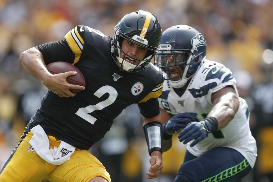 Pittsburgh Steelers quarterback Mason Rudolph (2) scrambles past Seattle Seahawks middle linebacker Bobby Wagner (54) for a first down in the second half of an NFL football game, Sunday, Sept. 15, 2019, in Pittsburgh. The Seahawks defeated the Steelers 28-26. (AP Photo/Don Wright)