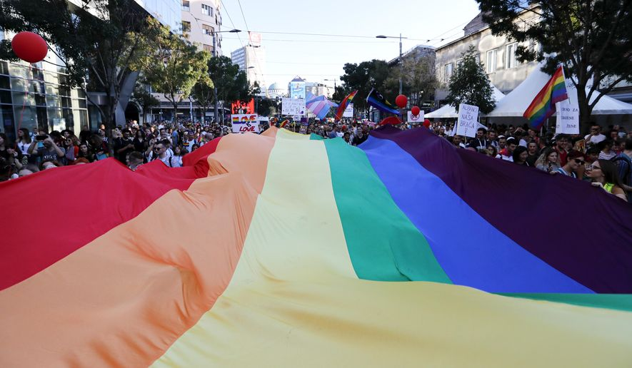 Participants wave a rainbow flag during the annual gay pride march in Belgrade, Serbia, Sunday, Sept. 15, 2019. (AP Photo/Darko Vojinovic) ** FILE **