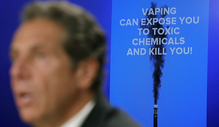 FILE - In this Sept. 9, 2019 file photo, New York Governor Andrew Cuomo speaks at a news conference about vaping and health concerns in New York. Cuomo says he's directing state health officials to ban the sale of flavored e-cigarettes, citing the risk of young people getting addicted to nicotine. The Democrat announced Sunday, Sept. 15 that the state health commissioner would be making a recommendation this week to the state Public Health and Health Planning Council. (AP Photo/Seth Wenig, File)