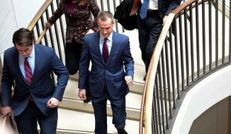 President Trump's former campaign manager Corey Lewandowski (center) is expected to be interviewed by the House Intelligence Committee regarding the Russia probe. (Associated Press)