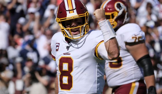 Washington Redskins quarterback Case Keenum (8) celebrates a touchdown during an NFL football game against the Dallas Cowboys, Sunday, Sept. 15, 2019, in Landover, Md. (AP Photo/Mark Tenally) ** FILE **