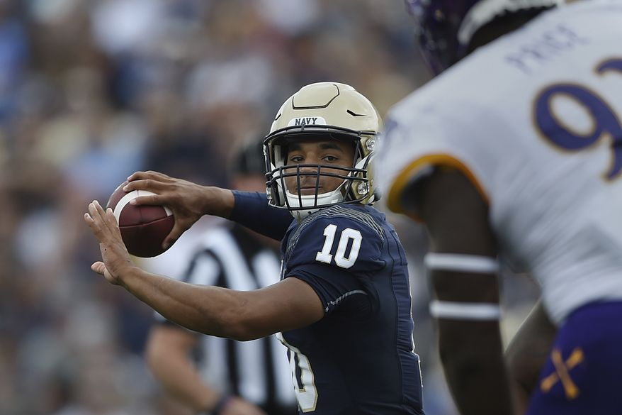 Navy quarterback Malcolm Perry throws the ball against East Carolina during an NCAA football game on Saturday, Sept. 14, 2019 in Baltimore. (AP Photo/Gail Burton)