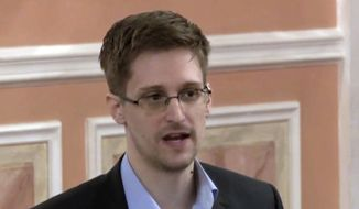 In this Oct. 11, 2013, file image made from video and released by WikiLeaks, former National Security Agency systems analyst Edward Snowden speaks in Moscow. Snowden, who leaked classified documents detailing government surveillance programs, is calling on French President Emmanuel Macron to grant him asylum. (AP Photo, File)