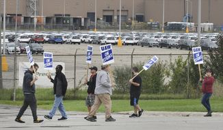 United Auto Workers picket on the south side of the General Motors Lake Orion Assembly plant in Lake Orion, Mich., Monday, Sept. 16, 2019. (Daniel Mears/Detroit News via AP)
