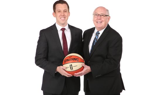 Washington Mystics associate coach Eric Thibault (left) poses with his father, Mystics head coach Mike Thibault. (Photo courtesy of NBAE / Ned Dishman)