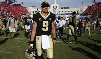New Orleans Saints quarterback Drew Brees walks off the field after the Saints were defeated by the Los Angeles Rams 27-9 in an NFL football game Sunday, Sept. 15, 2019, in Los Angeles. (AP Photo/Mark J. Terrill)