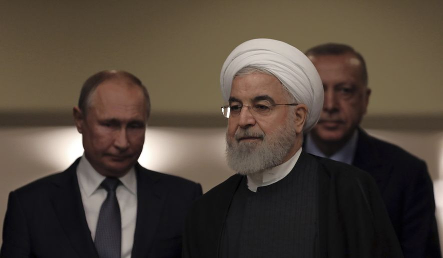 Turkish President Recep Tayyip Erdogan, right, Russia's President Vladimir Putin, left, and Iran's President Hassan Rouhani arrive for a news conference in Ankara, Turkey, Monday, Sept. 16, 2019. The leaders of Russia, Iran and Turkey met in the Turkish capital to discuss the situation in Syria, with the aim of halting fighting in the northwest of the country and finding a lasting political solution to the 8 1/2 year civil war. (AP Photo/Burhan Ozbilici)
